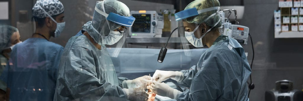 Physicians Performing Surgery on Patient with a Flex Arm Lamp